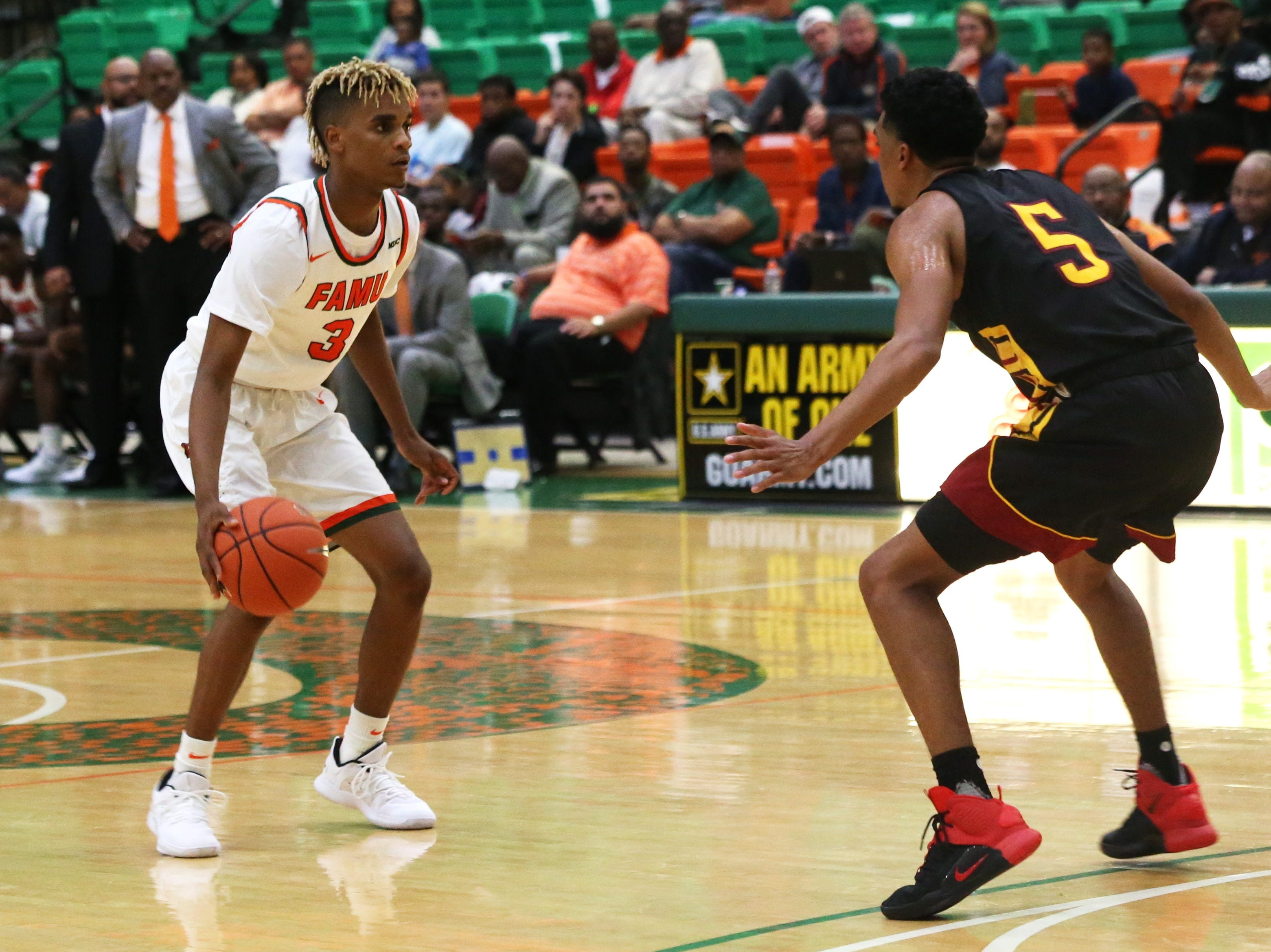 Florida A&M Rattlers guard MJ Randolph (3) does fancy footwork to throw off his defender as the FAMU Rattlers take on the Tuskegee Golden Tigers in their first home game of the season in the Lawson Center, Saturday, Nov. 10, 2018.