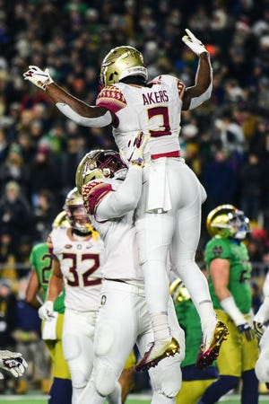 Sophomore running back Cam Akers, 3, celebrates scoring Florida State's first touchdown against Notre Dame with redshirt sophomore offensive lineman Jauan Williams during the second quarter in South Bend.