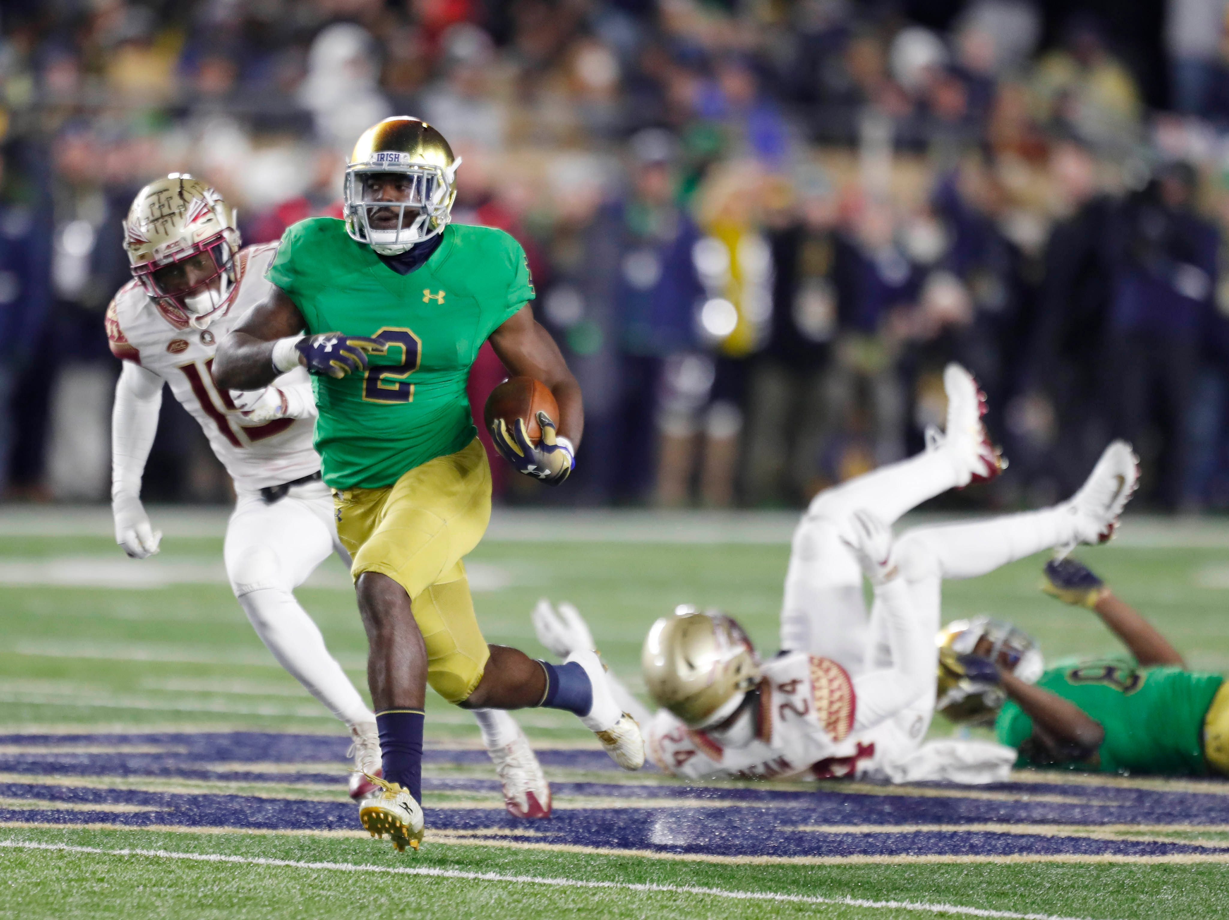 Nov 10, 2018; South Bend, IN, USA; Notre Dame Fighting Irish running back Dexter Williams (2) scores on a 58 yard touchdown run against the Florida State Seminoles during the second quarter at Notre Dame Stadium. Mandatory Credit: Brian Spurlock-USA TODAY Sports