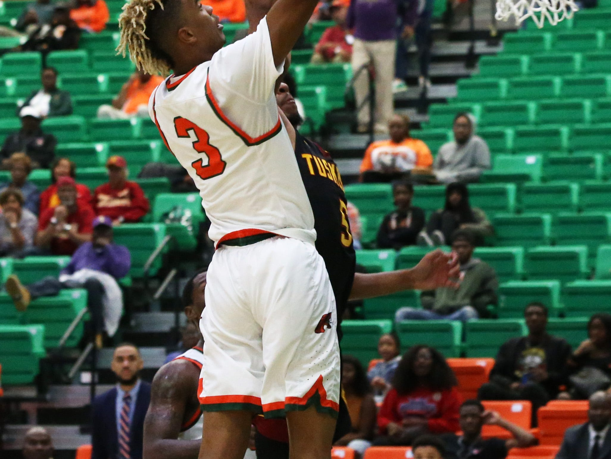 Florida A&M Rattlers guard MJ Randolph (3) goes for a layup as the FAMU Rattlers take on the Tuskegee Golden Tigers in their first home game of the season in the Lawson Center, Saturday, Nov. 10, 2018.