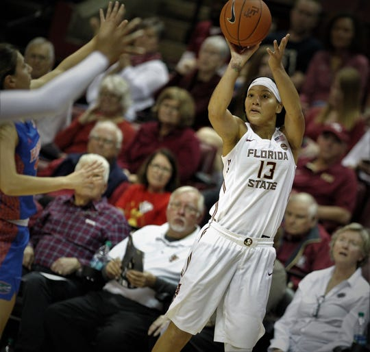 Florida State's Nausia Woolfolk takes a 3-pointer during the first half of the Seminoles' game against Florida at the Tucker Civic Center on Nov. 11, 2018.