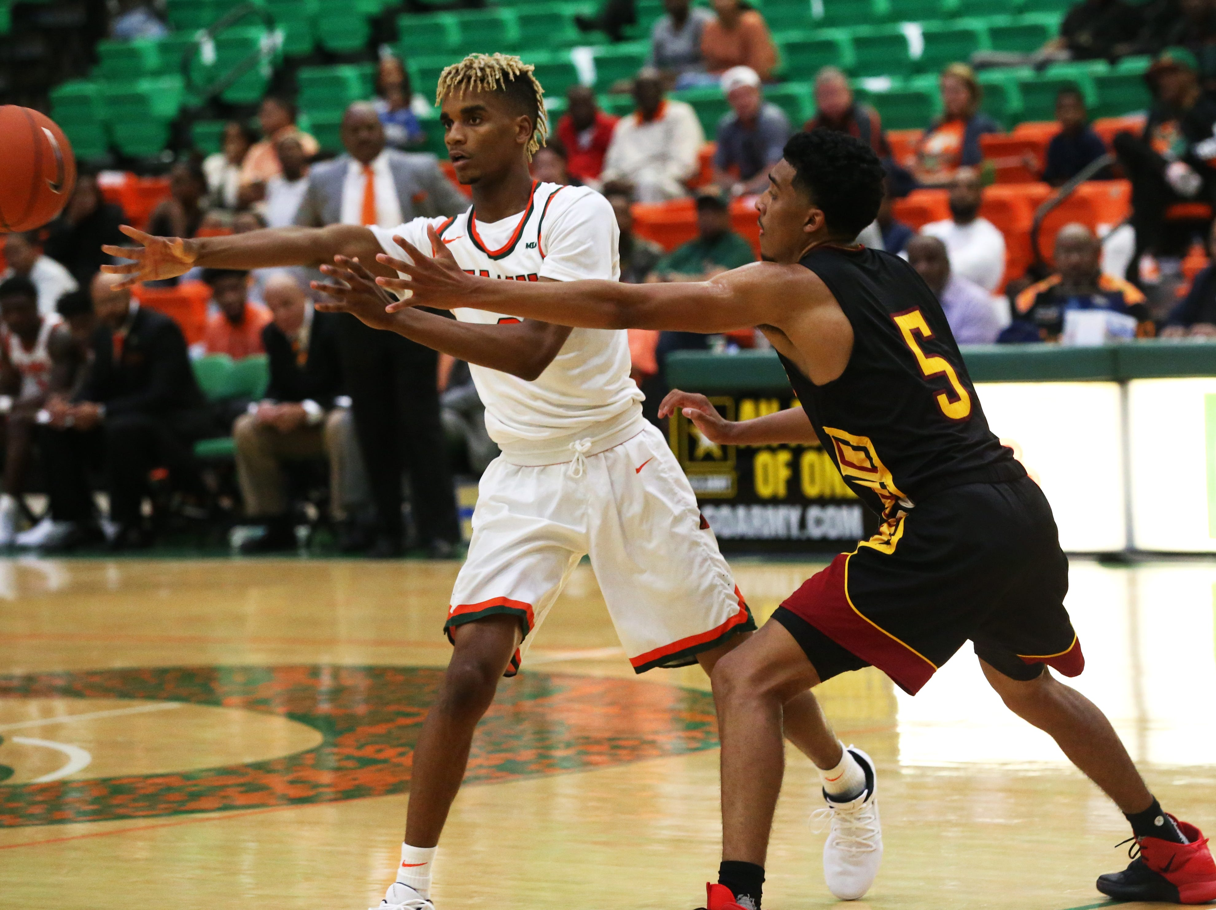 Florida A&M Rattlers guard MJ Randolph (3) passes to a teammate as the FAMU Rattlers take on the Tuskegee Golden Tigers in their first home game of the season in the Lawson Center, Saturday, Nov. 10, 2018.