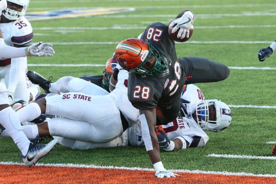 FAMU running back Ricky Henrilus scores a touchdown against South Carolina State in the second quarter. The Rattlers lost 44-21 and fall to 6-4 on the season.