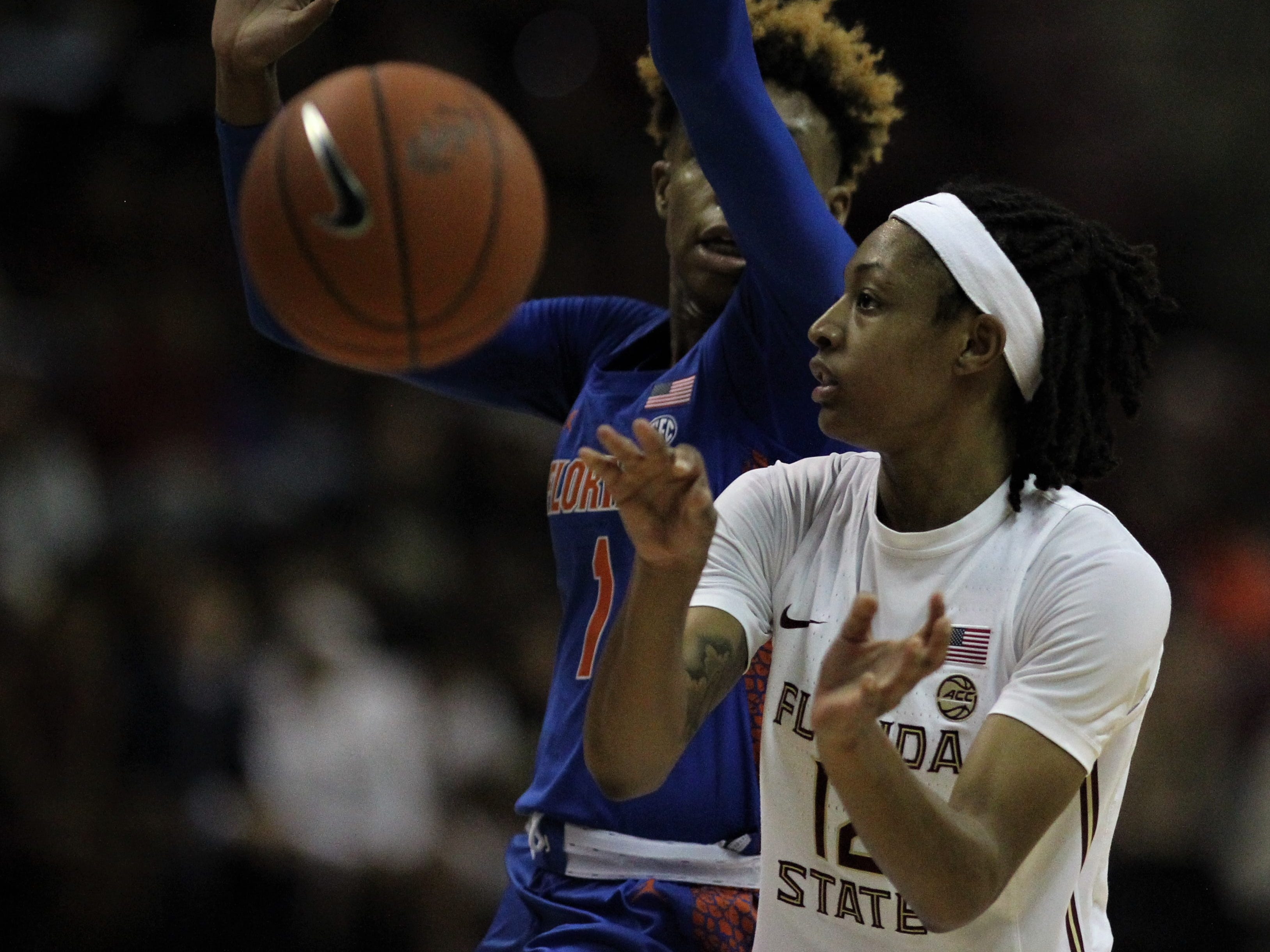 Florida State guard Nicki Ekhomu throws a no-look pass during the first half of the Seminoles' game against Florida at the Tucker Civic Center on Nov. 11, 2018.