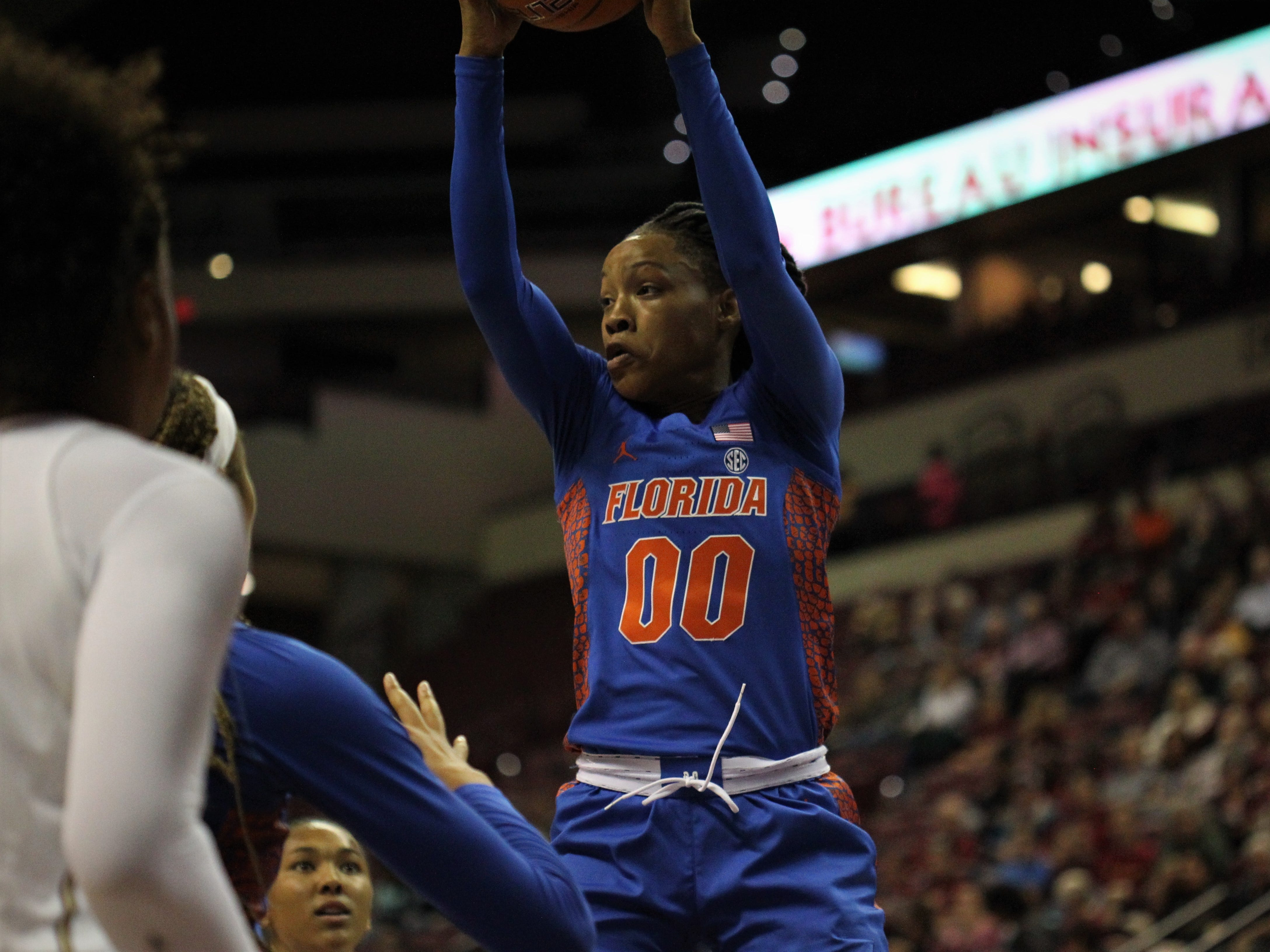 Florida's Delicia Washington grabs a rebound during the first half of a game against Florida State at the Tucker Civic Center on Nov. 11, 2018.
