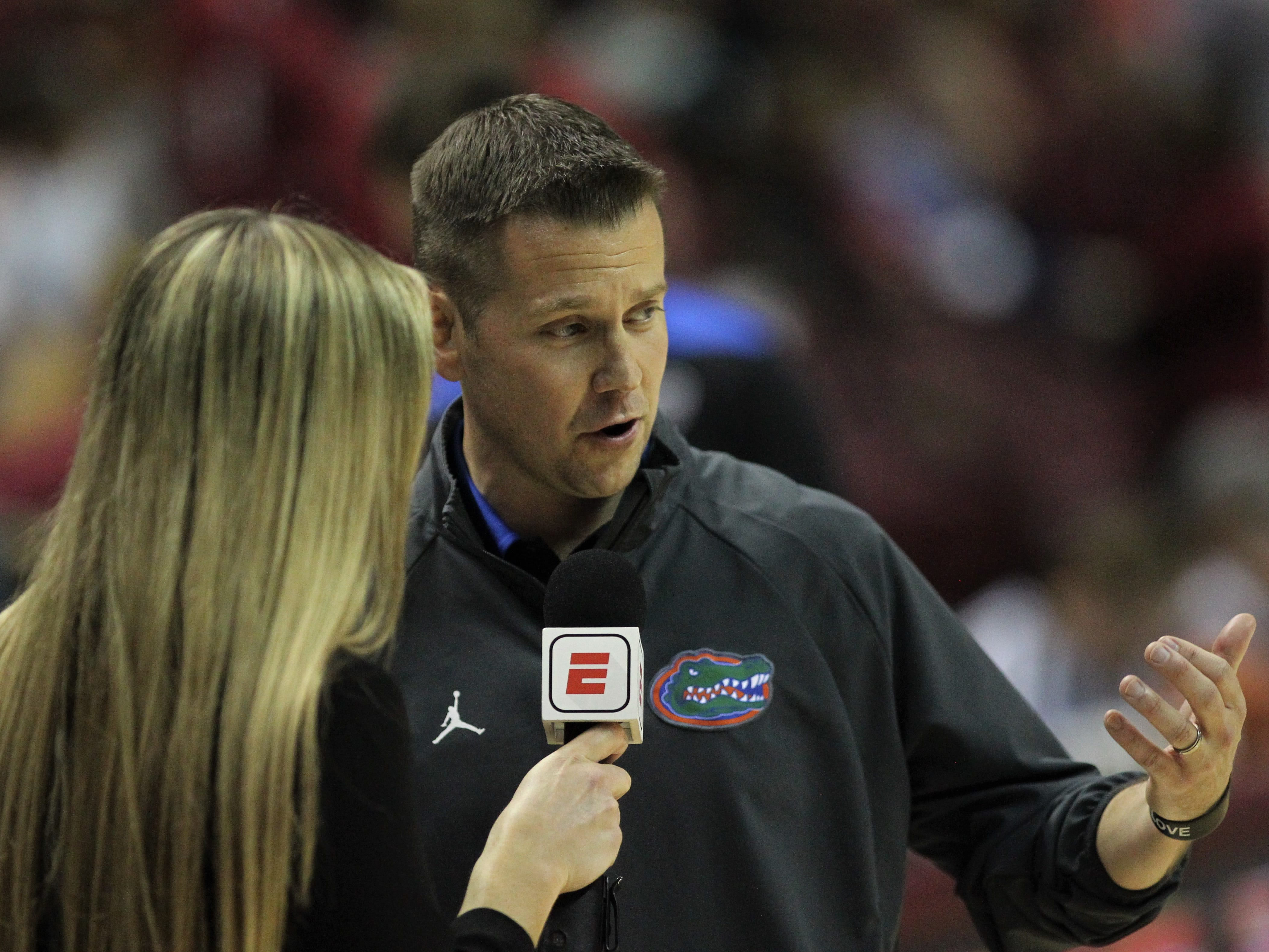 Florida women's basketball coach Cameron Newbauer talks to ESPN after the first half of a game against FSU at the Tucker Civic Center on Nov. 11, 2018.