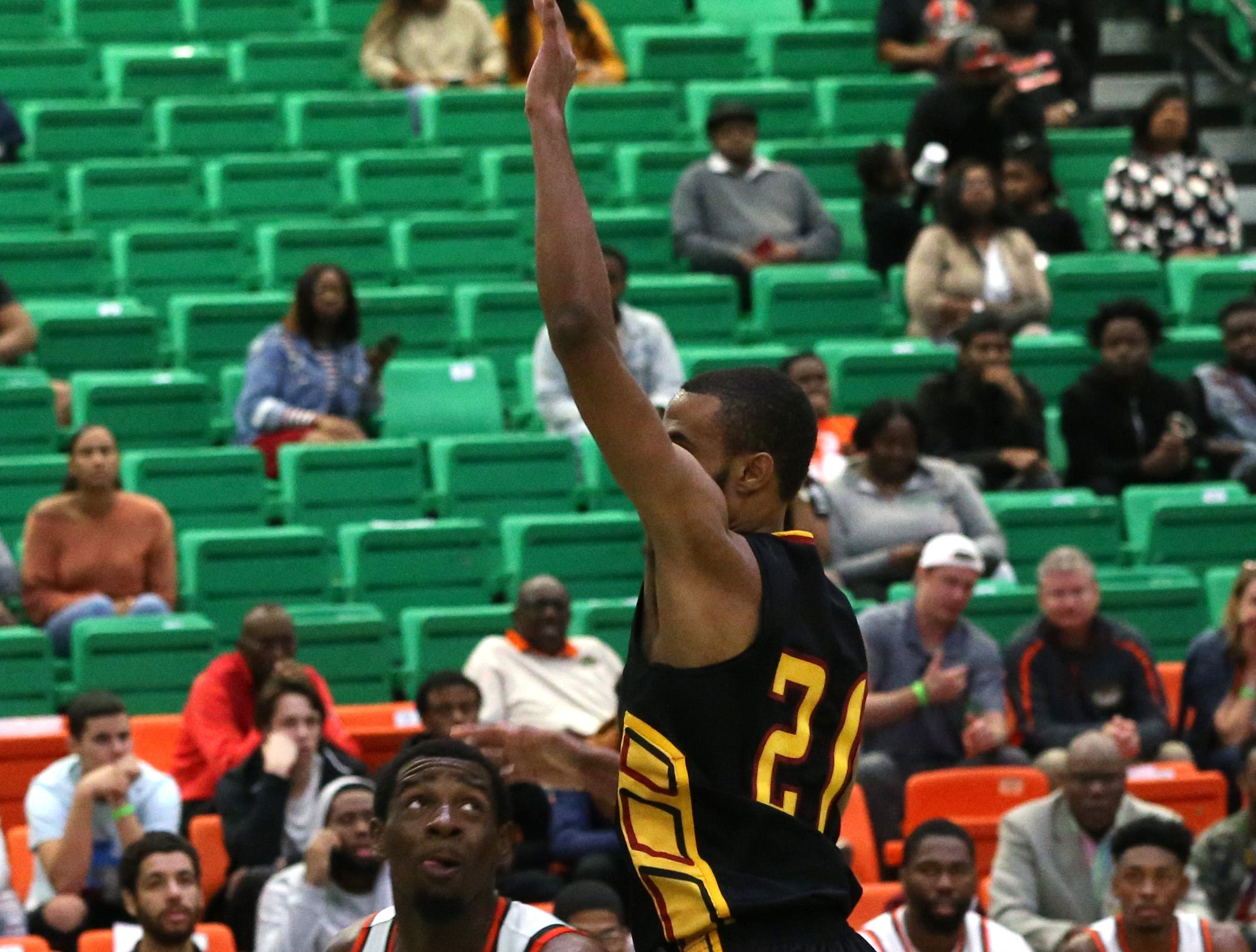 Florida A&M Rattlers forward Tracy Hector Jr. (0) attempts to shoot as the FAMU Rattlers take on the Tuskegee Golden Tigers in their first home game of the season in the Lawson Center, Saturday, Nov. 10, 2018.