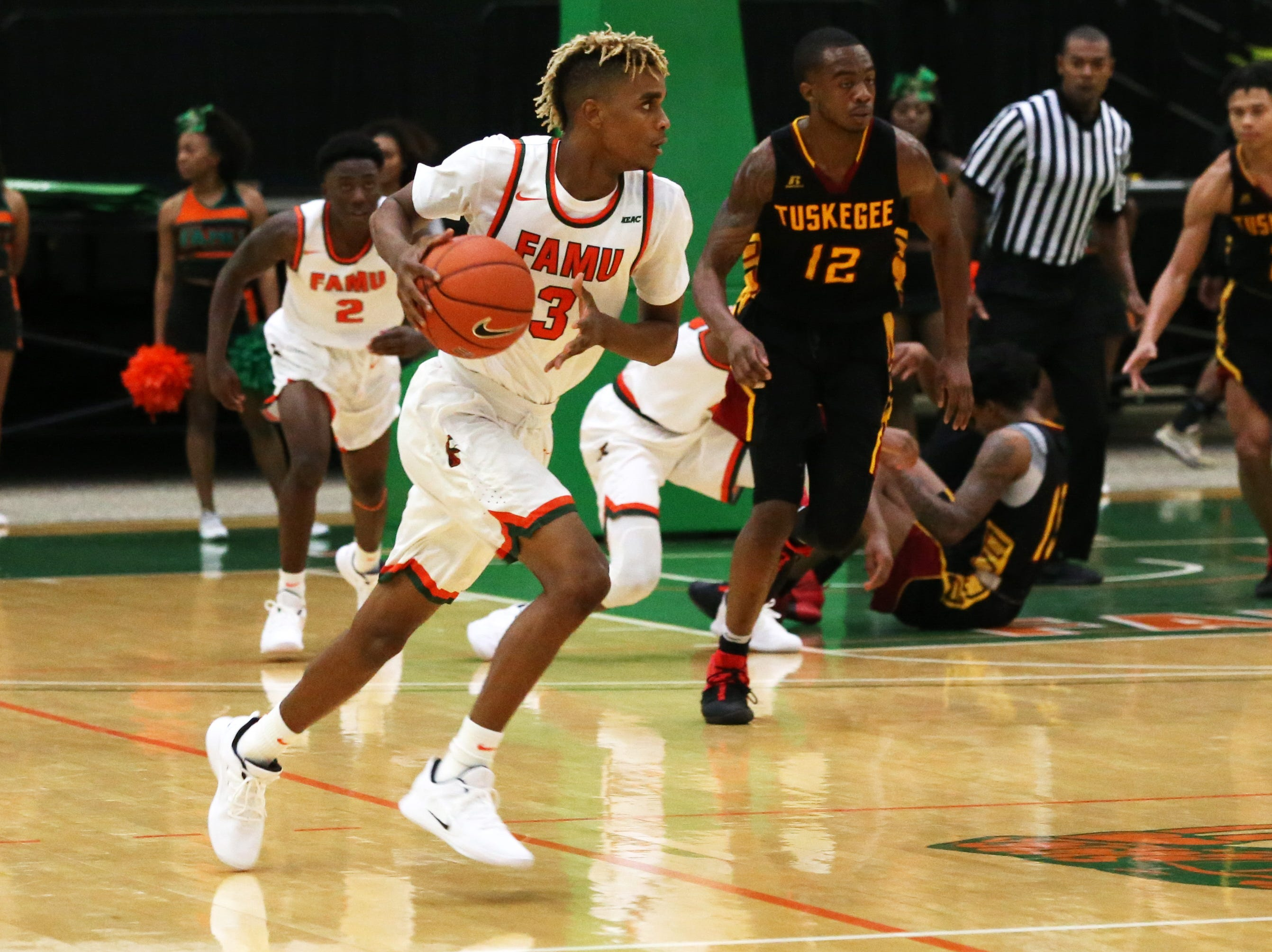 Florida A&M Rattlers guard MJ Randolph (3) takes the rebound and drives down the court as the FAMU Rattlers take on the Tuskegee Golden Tigers in their first home game of the season in the Lawson Center, Saturday, Nov. 10, 2018.