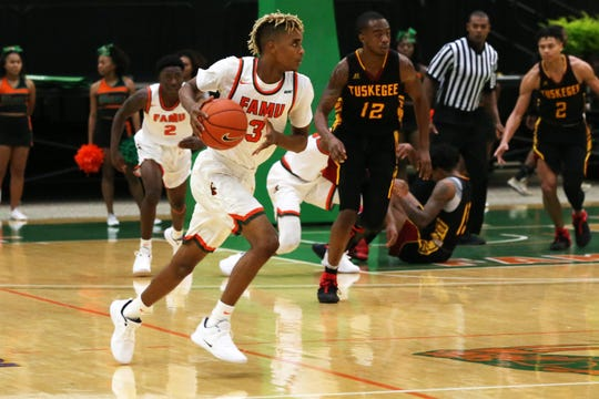 Florida A&M guard M.J. Randolph takes the rebound and drives versus Tuskegeei n the first home game of the season on Saturday, Nov. 10, 2018.