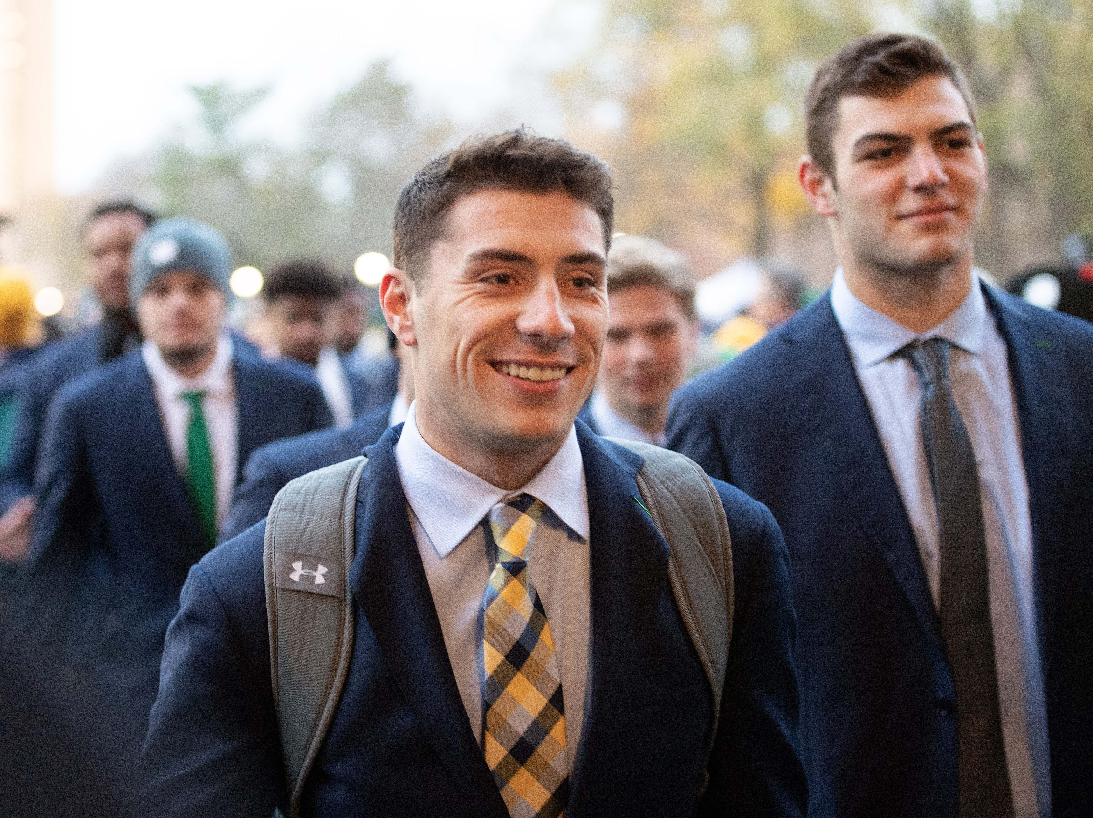Nov 10, 2018; South Bend, IN, USA; Notre Dame Fighting Irish quarterback Ian Book walks in to Notre Dame Stadium before the game against the Florida State Seminoles. Mandatory Credit: Matt Cashore-USA TODAY Sports