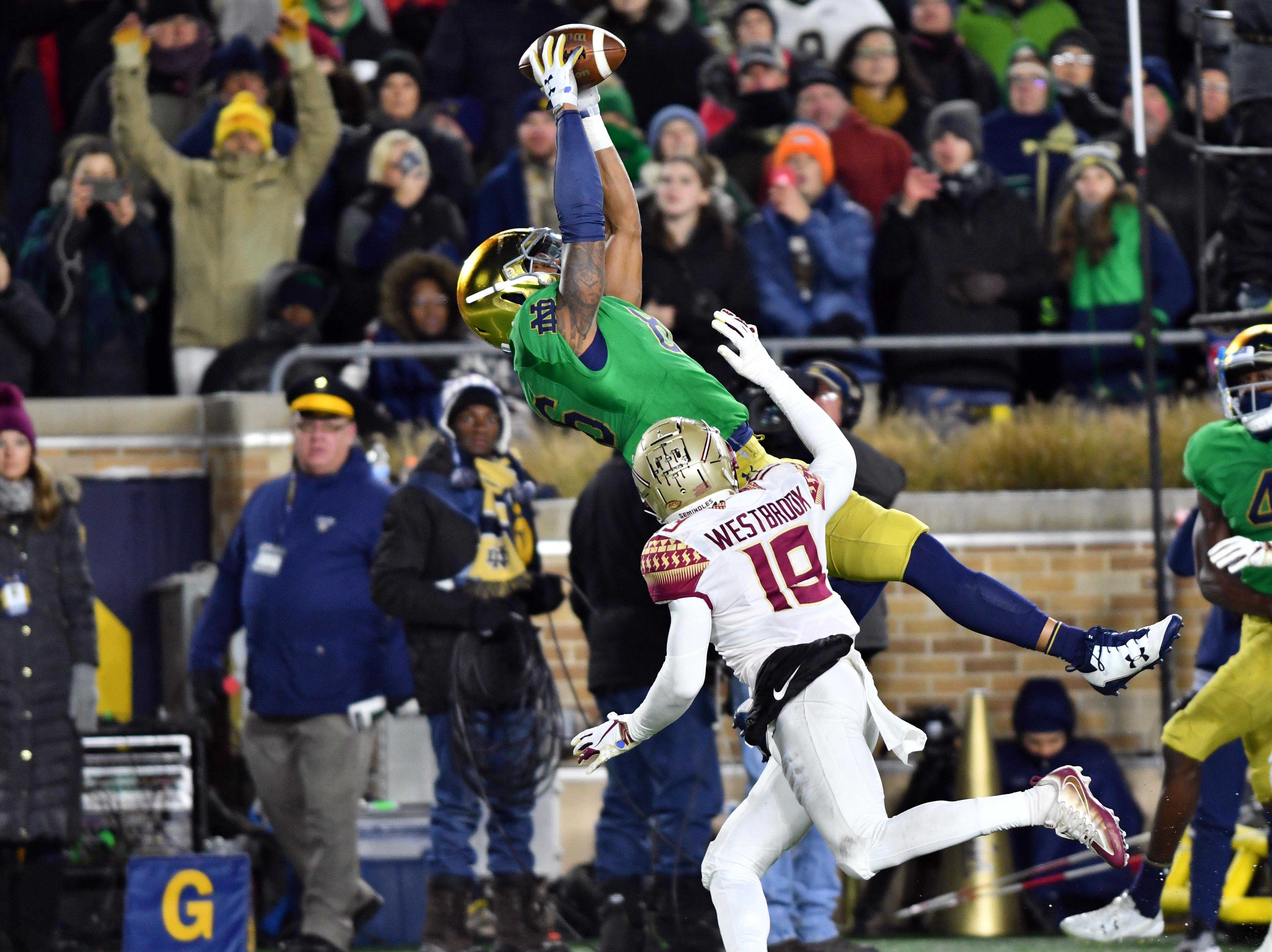 Nov 10, 2018; South Bend, IN, USA; Notre Dame Fighting Irish tight end Alize Mack (86) catches a pass for a touchdown over Florida State Seminoles defensive back A.J. Westbrook (19) in the second quarter at Notre Dame Stadium. Mandatory Credit: Matt Cashore-USA TODAY Sports