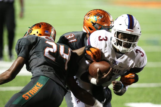 FAMU defenders had a hard time containing South Carolina State quarterback Tyrece Nick (3) in a 44-21 rout in 2018 at Bragg Memorial Stadium.