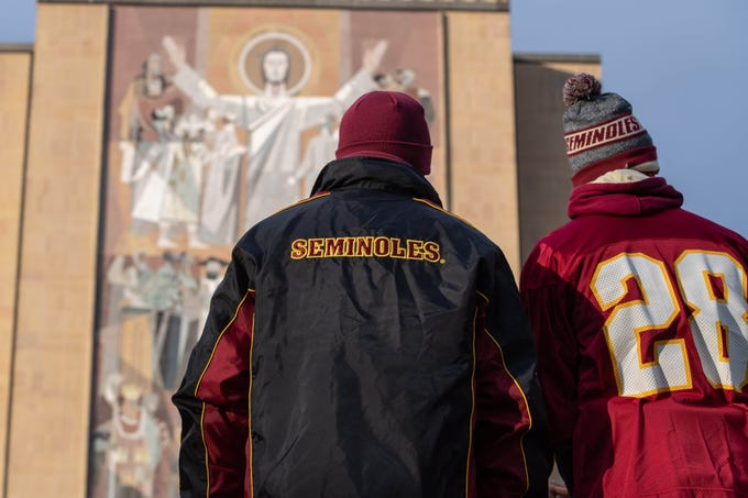 Nov 10, 2018; South Bend, IN, USA; Florida State fans visit the Word of Life Mural, commonly known as Touchdown Jesus before a game between the Notre Dame Fighting Irish and the Florida State Seminoles at Notre Dame Stadium. Mandatory Credit: Matt Cashore-USA TODAY Sports