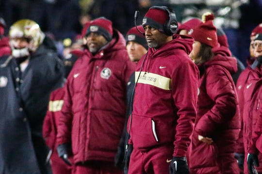 Florida State Willie Taggart glances at the scoreboard as the Notre Dame Fighting Irish put up 32 points in the first half against the Seminoles in South Bend on Saturday.