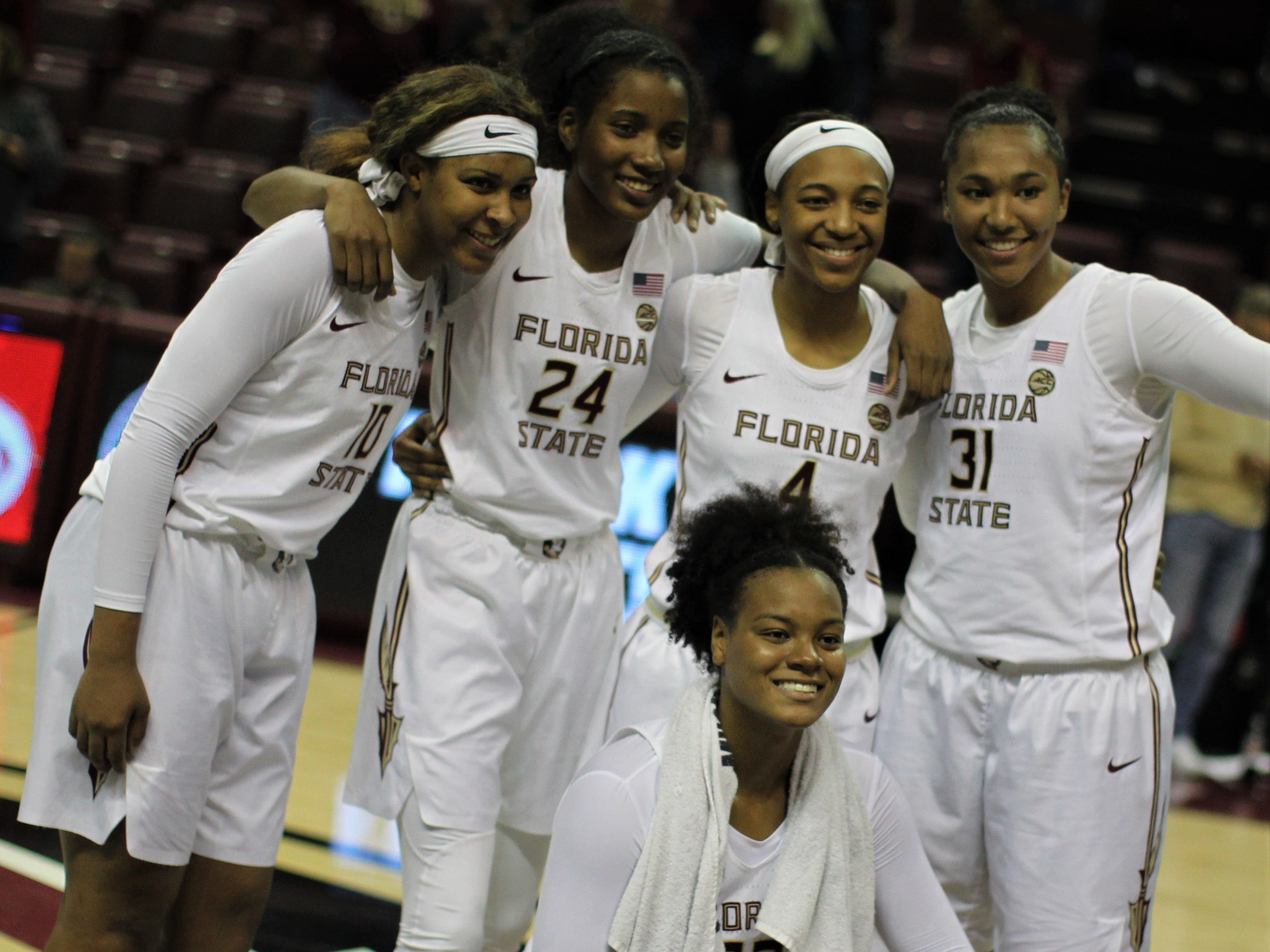 Florida State's Kourney Weber (10), Morgan Jones (24), Amaya Brown (4), Savannah Wilkinson (31) and Valencia Myers (32) celebrate a win over Florida at the Tucker Civic Center on Nov. 11, 2018.
