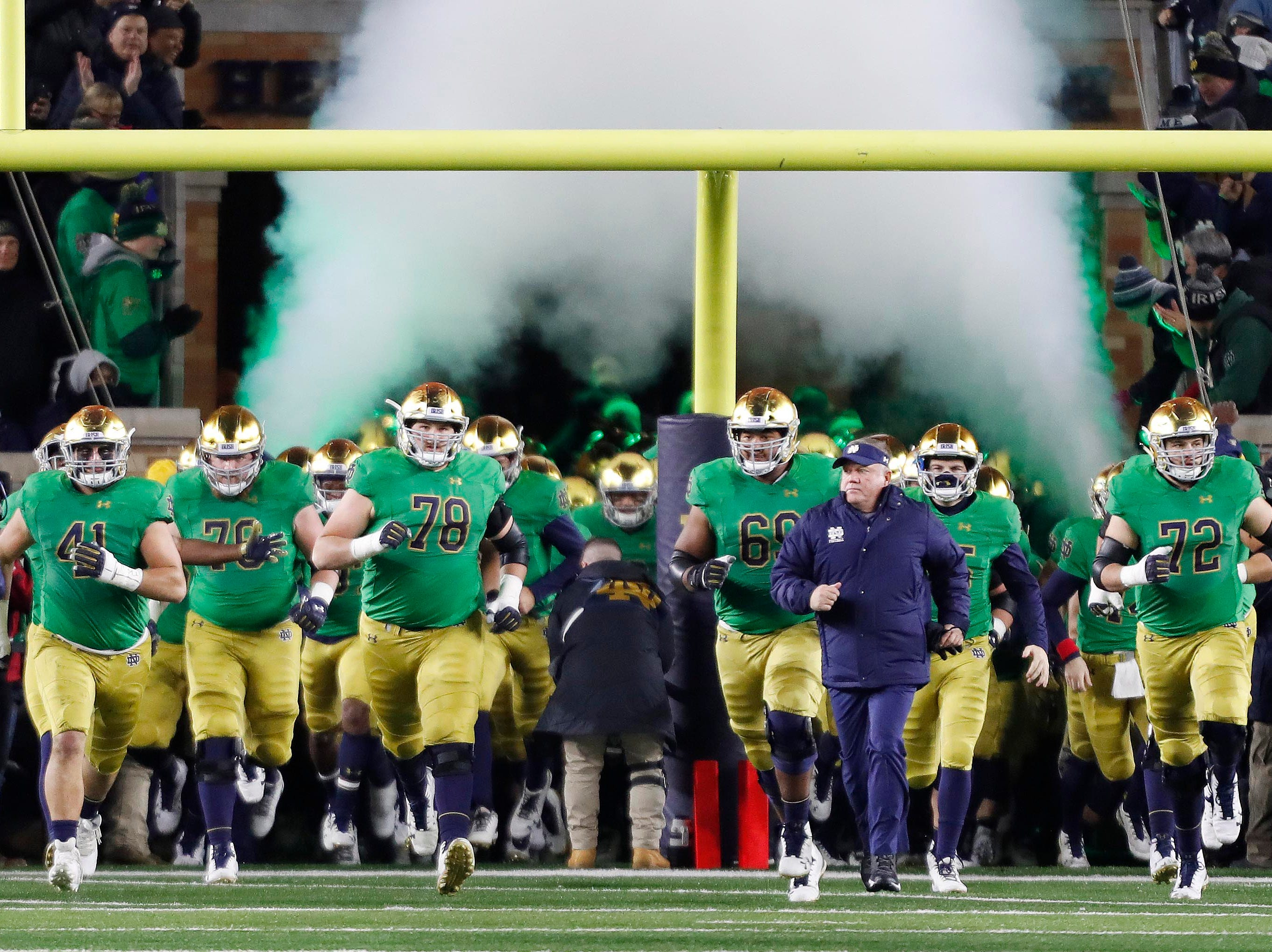 Nov 10, 2018; South Bend, IN, USA; Notre Dame Fighting Irish coach Brian Kelly leads the team onto the field before the game against the Florida State Seminoles at Notre Dame Stadium. Mandatory Credit: Brian Spurlock-USA TODAY Sports