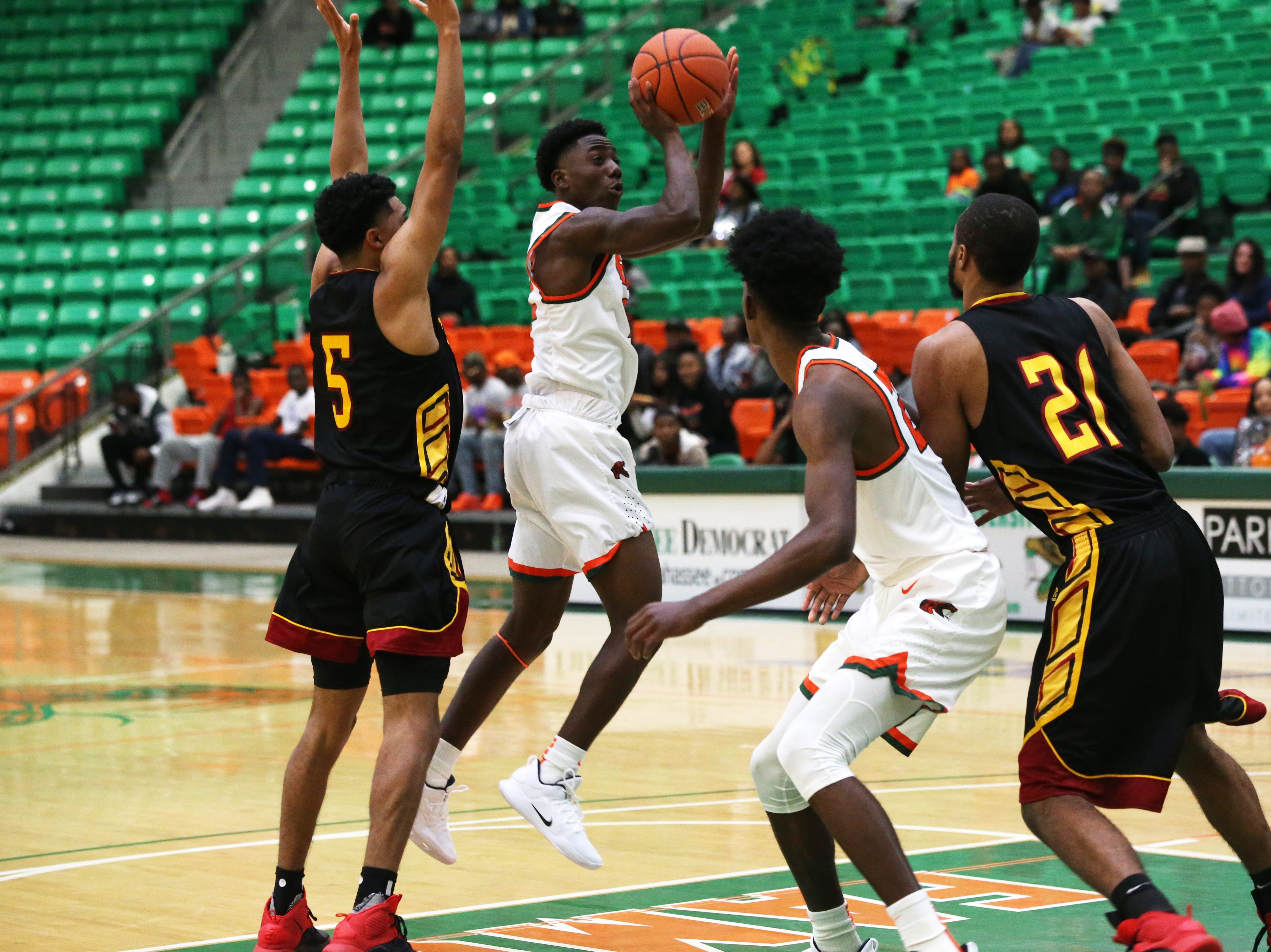 Florida A&M Rattlers guard Kamron Reaves (2) goes for the shot as the FAMU Rattlers take on the Tuskegee Golden Tigers in their first home game of the season in the Lawson Center, Saturday, Nov. 10, 2018.