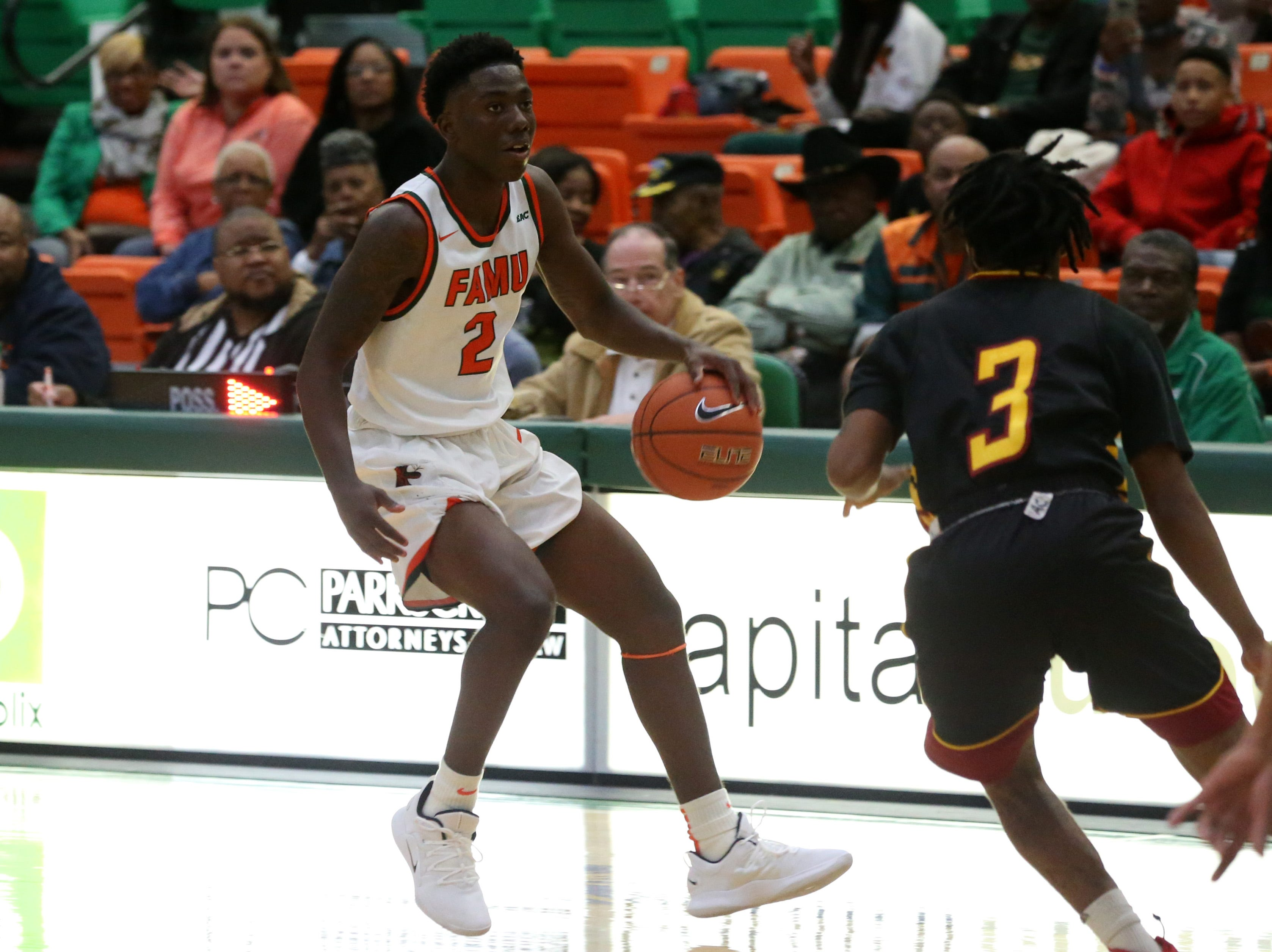 Florida A&M Rattlers guard Kamron Reaves (2) moves to get around his defender as the FAMU Rattlers take on the Tuskegee Golden Tigers in their first home game of the season in the Lawson Center, Saturday, Nov. 10, 2018.