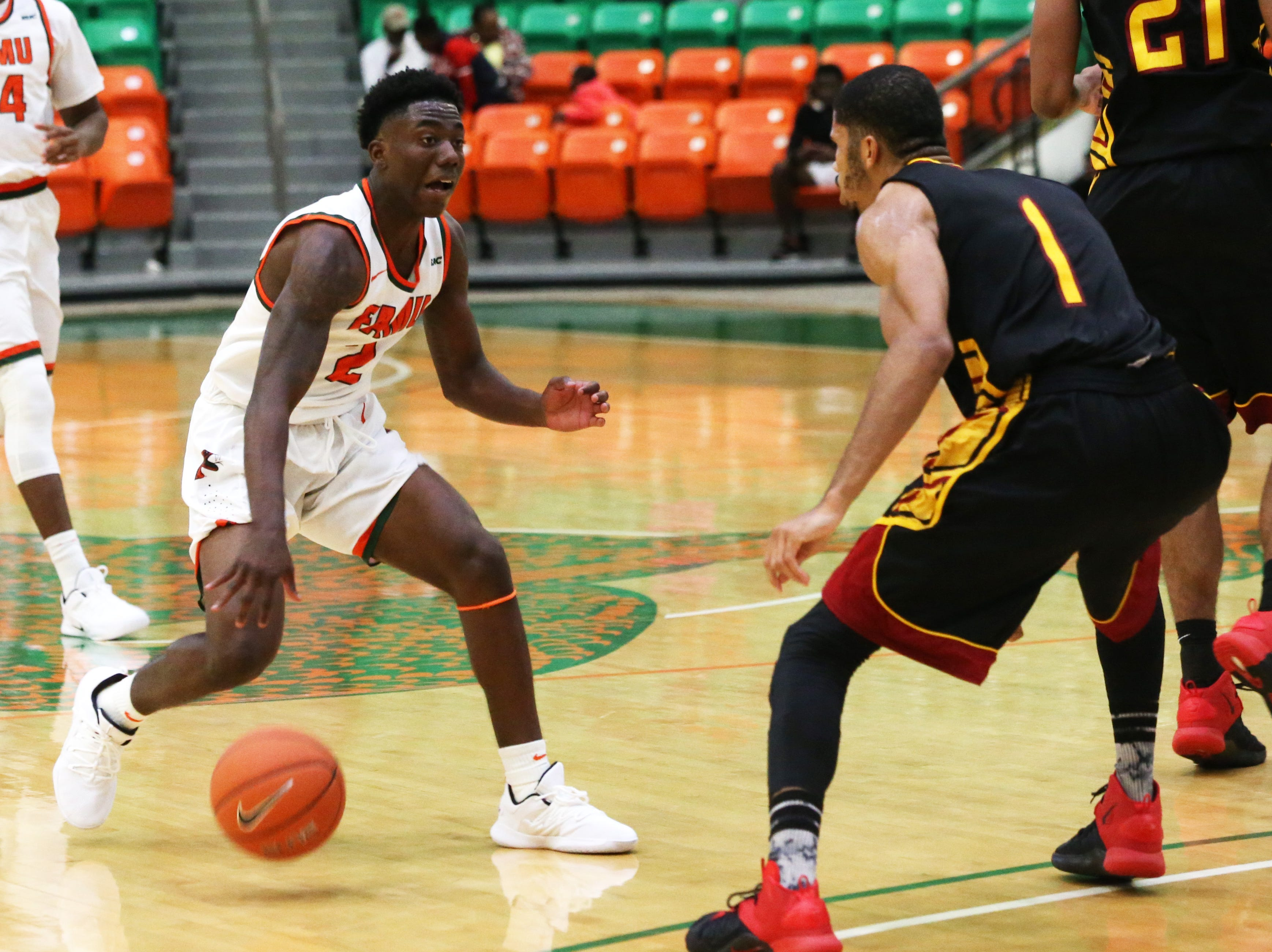 Florida A&M Rattlers guard Kamron Reaves (2) tries to maneuver around his defender as the FAMU Rattlers take on the Tuskegee Golden Tigers in their first home game of the season in the Lawson Center, Saturday, Nov. 10, 2018.