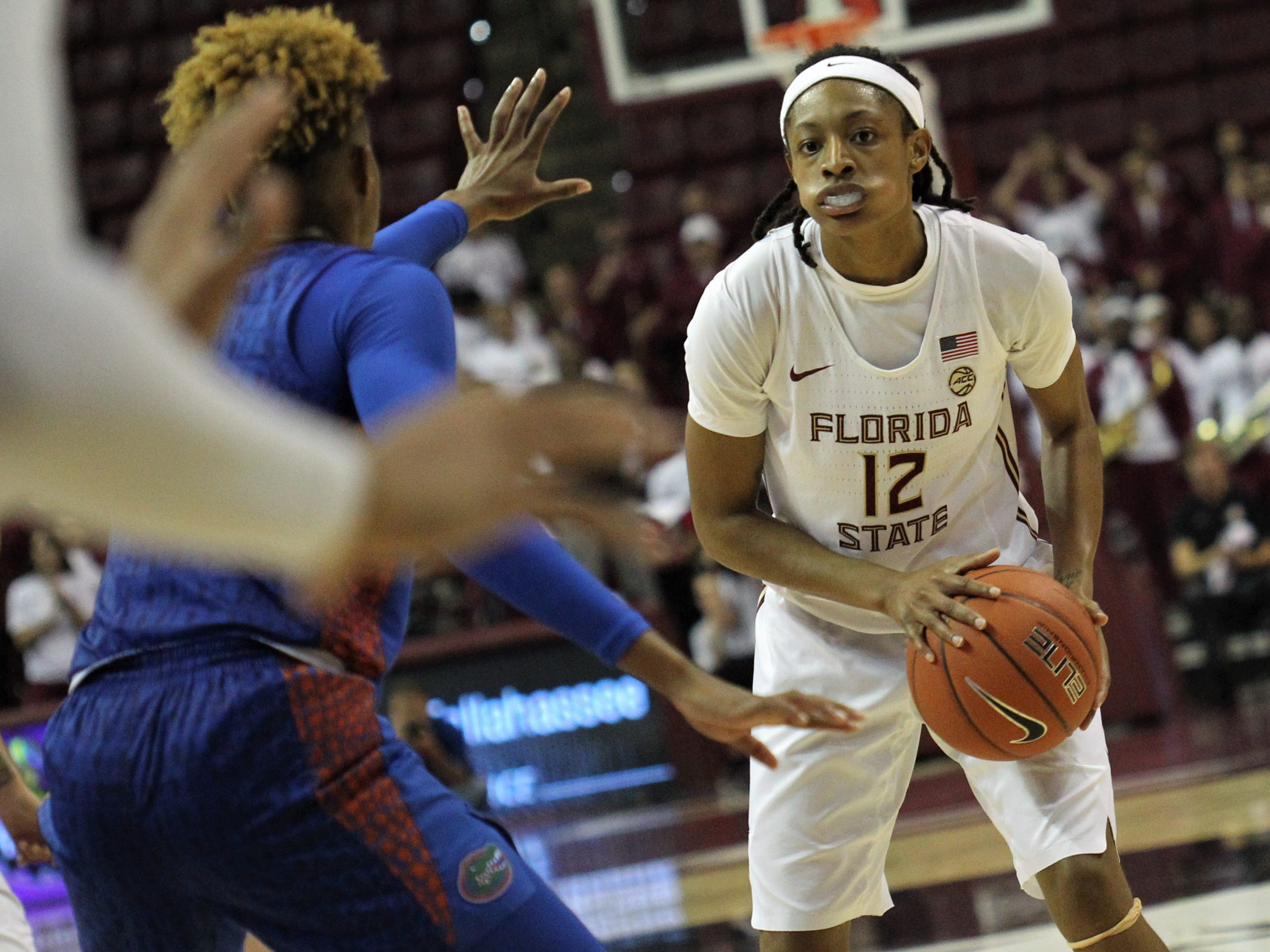 Florida State's Nicki Ekhomu looks for a pass to the post during the second half of the Seminoles' game against Florida at the Tucker Civic Center on Nov. 11, 2018.