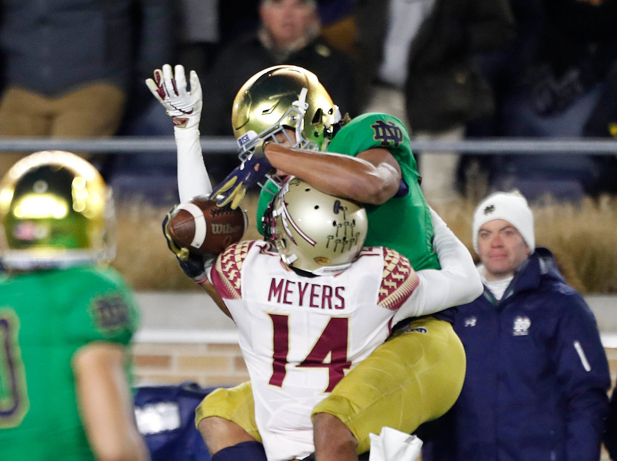 Nov 10, 2018; South Bend, IN, USA; Notre Dame Fighting Irish wide receiver (83) is interfered with by Florida State Seminoles defensive back Kyle Meyers (14) during the first quarter at Notre Dame Stadium. Mandatory Credit: Brian Spurlock-USA TODAY Sports