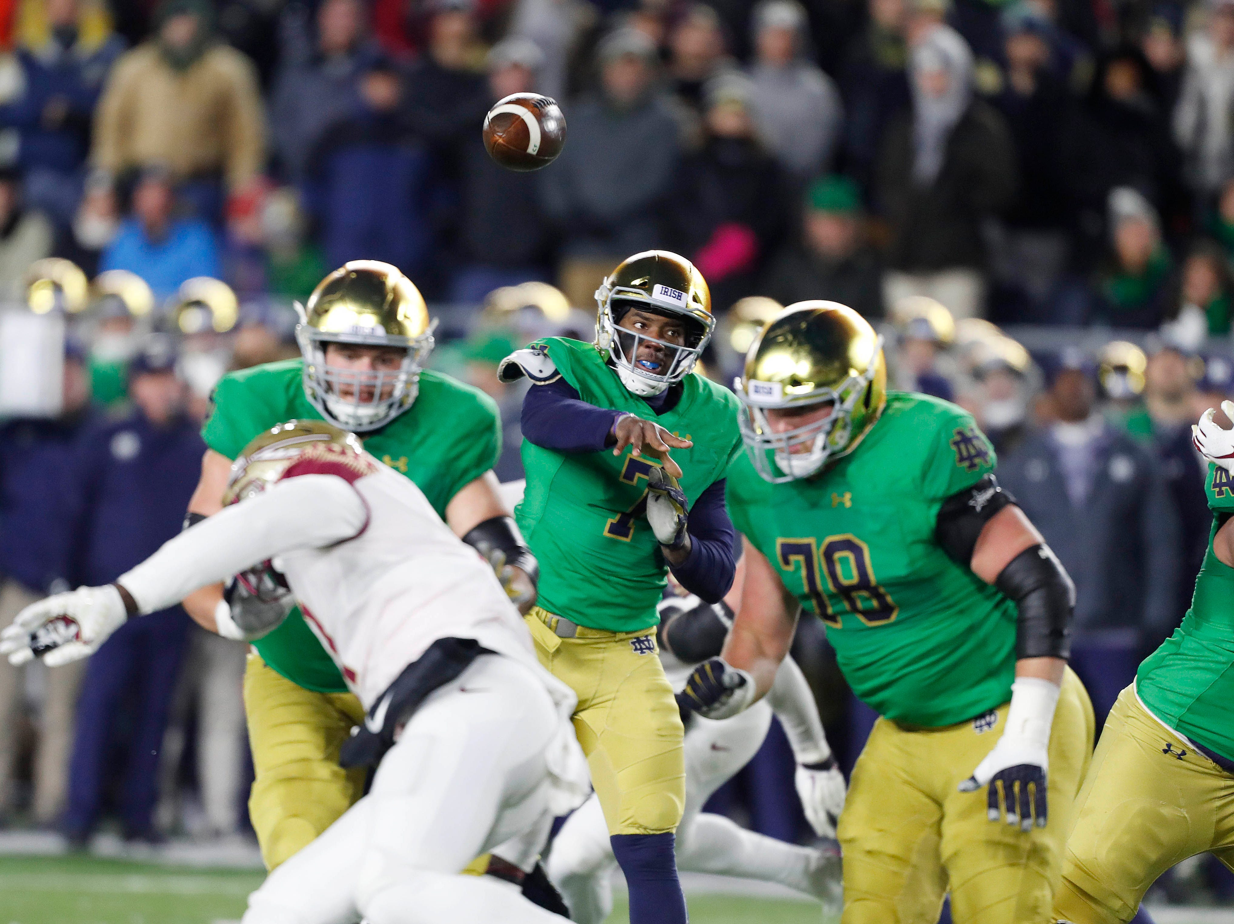 Nov 10, 2018; South Bend, IN, USA; Notre Dame Fighting Irish quarterback Brandon Wimbush (7) throws a pass against the Florida State Seminoles during the first quarter at Notre Dame Stadium. Mandatory Credit: Brian Spurlock-USA TODAY Sports