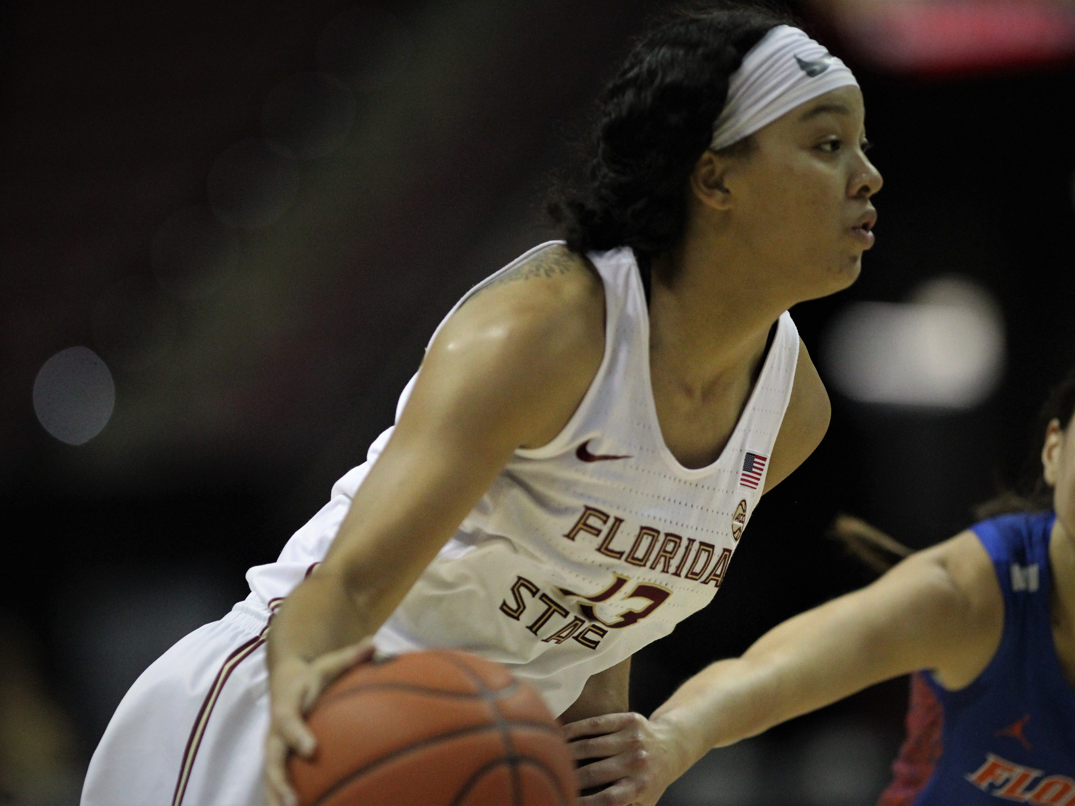 Florida State's Nausia Woolfolk drives to the basket during the first half of the Seminoles' game against Florida at the Tucker Civic Center on Nov. 11, 2018.