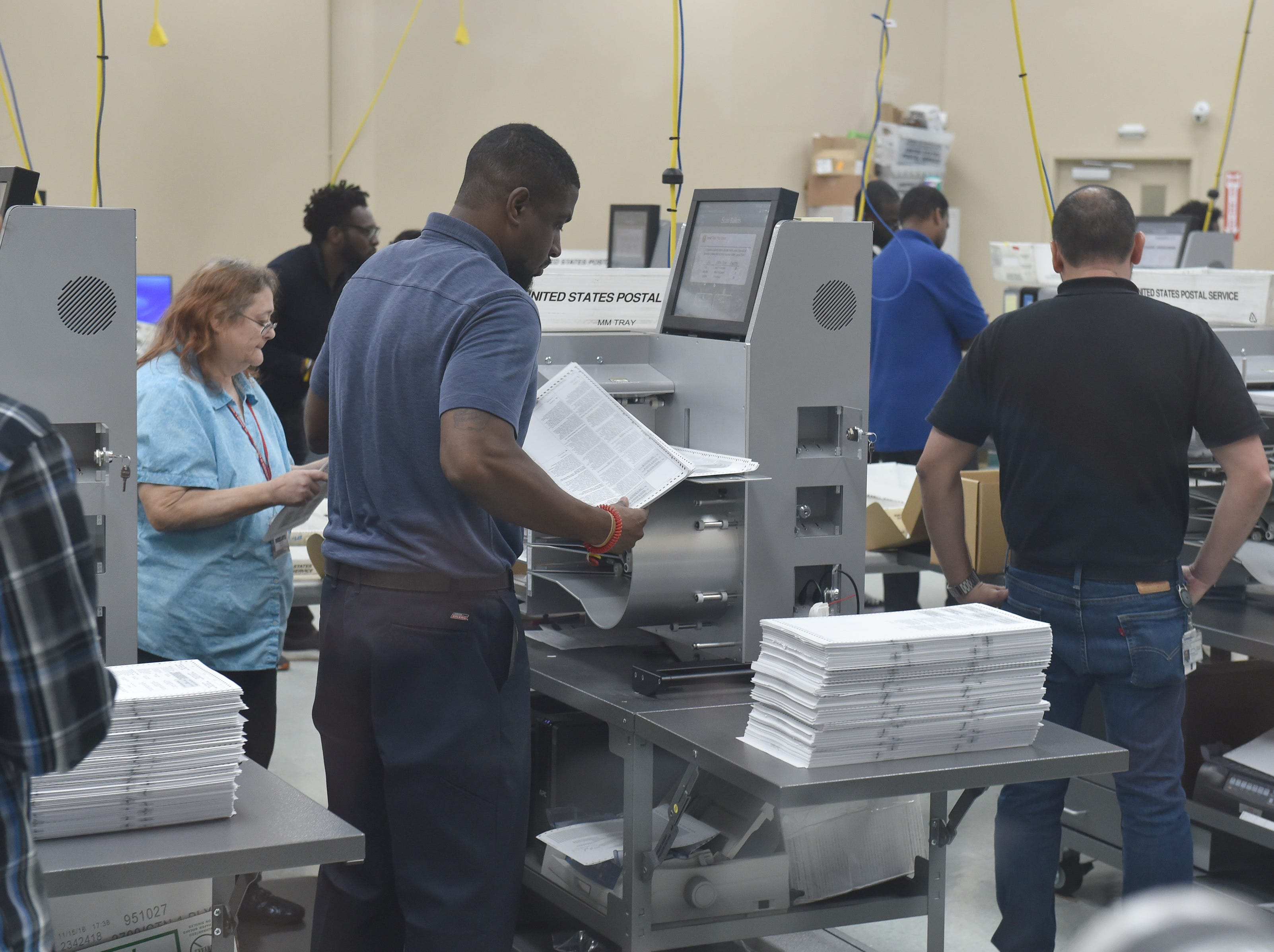 Broward County Supervisor of Election's office works a more than 30-hour operation of sorting the first page of ballots from 3.5 million pages of ballots on Sunday, Nov. 11, 2018, at the elections office in Lauderhill, Florida. The Secretary of State has ordered a machine recount in the Governor, U.S. Senate, and the Florida Commissioner of Agriculture contests.