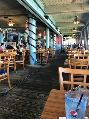 Dining area at Manatee Island Grill & Bar in Fort Pierce. The restaurant has Manatee Island has a fun, casual, waterfront décor .