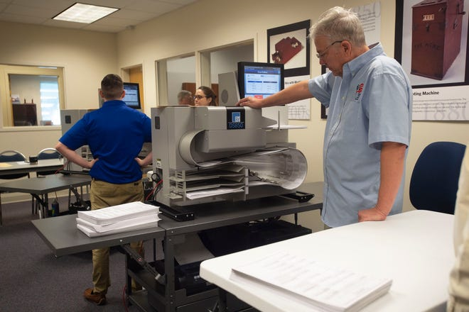 Indian River County Supervisor of Elections IT Manager Gary Gordon feeds ballots into a machine during a recount Sunday, Nov. 11, 2018, at the county's elections office in Indian River County. Secretary of State Ken Detzner ordered recounts in the elections for governor, U.S. Senator and agriculture commissioner because the results provided to the state from the margin from all three races were less than one-half of one percent.