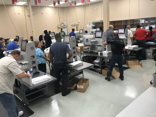Workers sort ballots during the Broward County Supervisor of Elections mandatory recount on Sunday, November 11, 2018, in Lauderhill Florida.