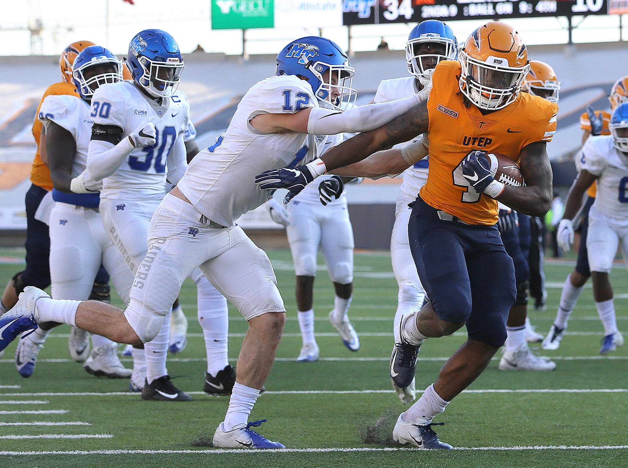 UTEP junior running back Quardraiz Wadley steps into the end zone past Middle Tennessee's Reed Blankenship on Saturday at Sun Bowl Stadium. UTEP lost to the Blue Raiders 48-32.