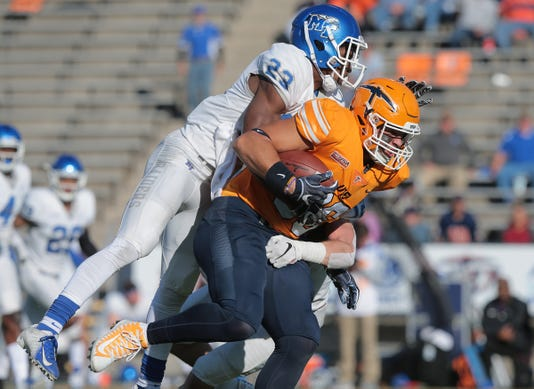27 Utep Junior Running Back Quardraiz Wadley Steps Into The Endzone Past Middle Tennessees Reed Blankenship Saturday At The Sun Bowl Utep Lost To The Blue Raiders 48 32