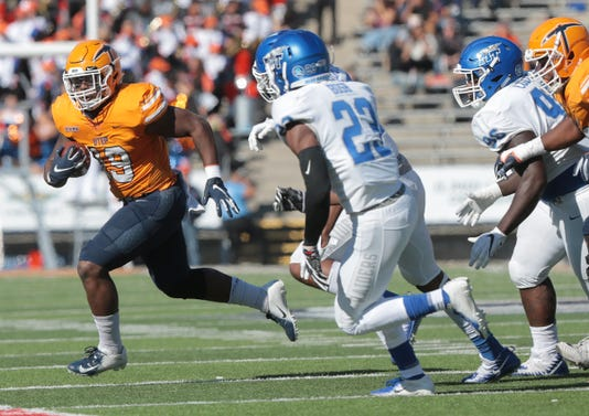 29 Utep Junior Running Back Quardraiz Wadley Steps Into The Endzone Past Middle Tennessees Reed Blankenship Saturday At The Sun Bowl Utep Lost To The Blue Raiders 48 32