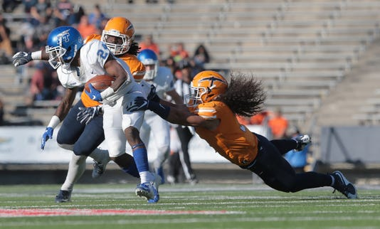28 Utep Junior Running Back Quardraiz Wadley Steps Into The Endzone Past Middle Tennessees Reed Blankenship Saturday At The Sun Bowl Utep Lost To The Blue Raiders 48 32