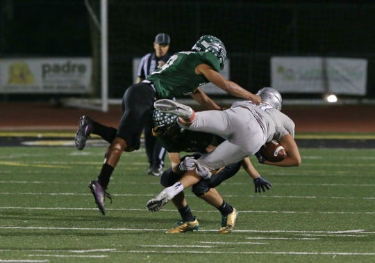 Mayfair High's Byan Dubon is upended by two Pacifica players during Saturday's playoff game.