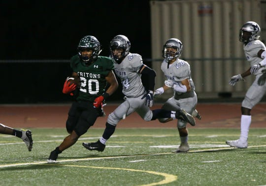 Malik Sherrod avoids a slew of Mayfield defenders en route to a touchdown run in Pacifica's 31-28 overtime win Saturday night at Ventura High. The Tritons advanced to the Division 6 semifinals.