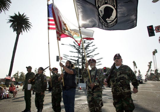 Members of the 187th Airborne Ventura Chapter marched in the Oxnard Veterans Day parade and ceremony at Plaza Park in 2018.
