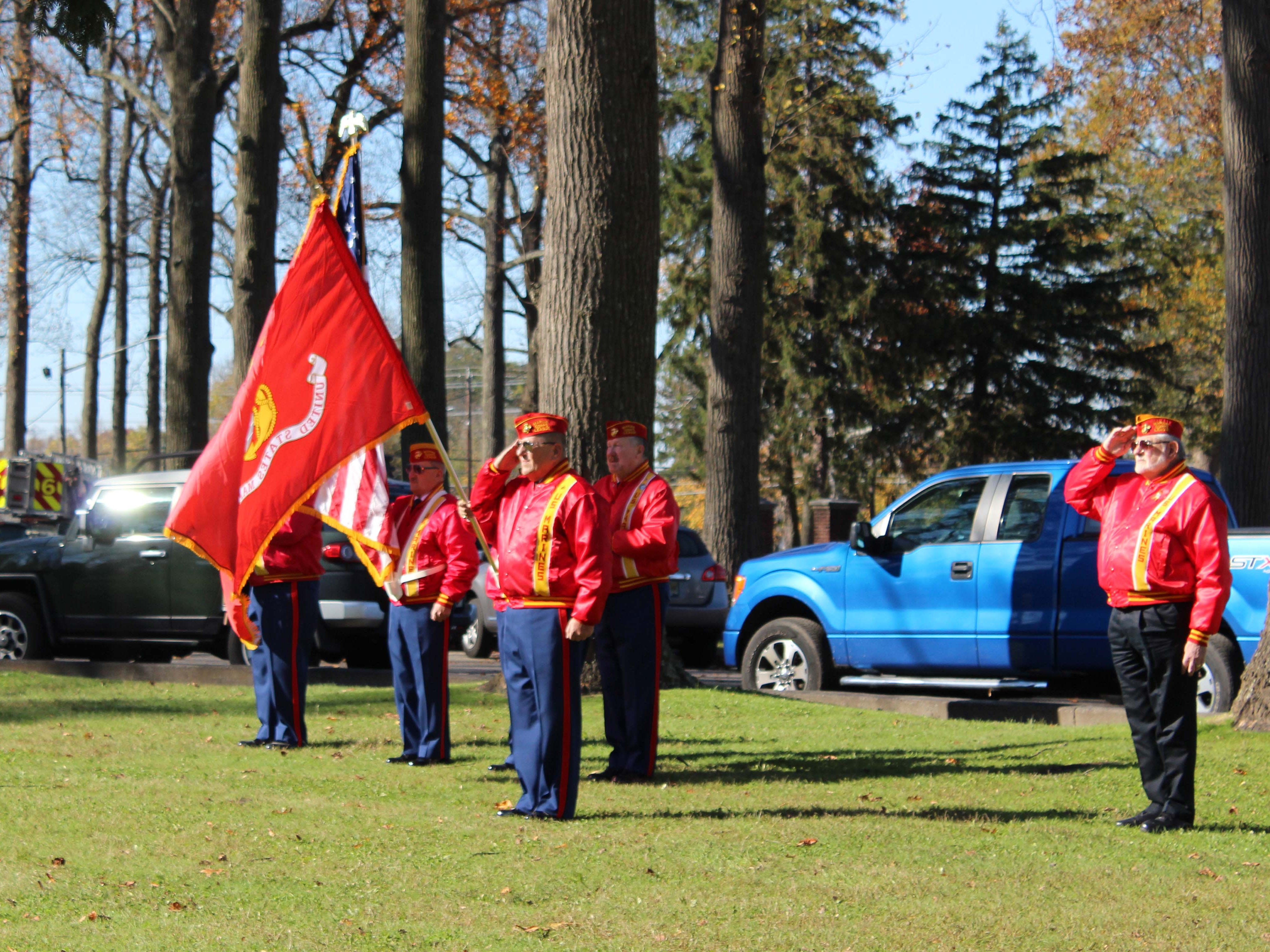 Marine Veterans salute the Flag during the national anthem on Sunday morning.