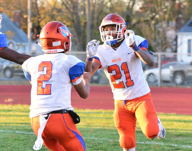Millville's Dashon Byers (right) celebrates a touchdown with Eddie Jamison during the Bolts' 28-26 loss to Shawnee on Saturday.