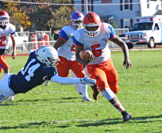 Millville's Tex Thompson carries the ball during a 28-26 loss to Shawnee on Saturday.