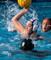 Redwood's Emma Peters shoots against Porterville in a Central Section Division II girls water polo championship on Saturday, November 10, 2018.