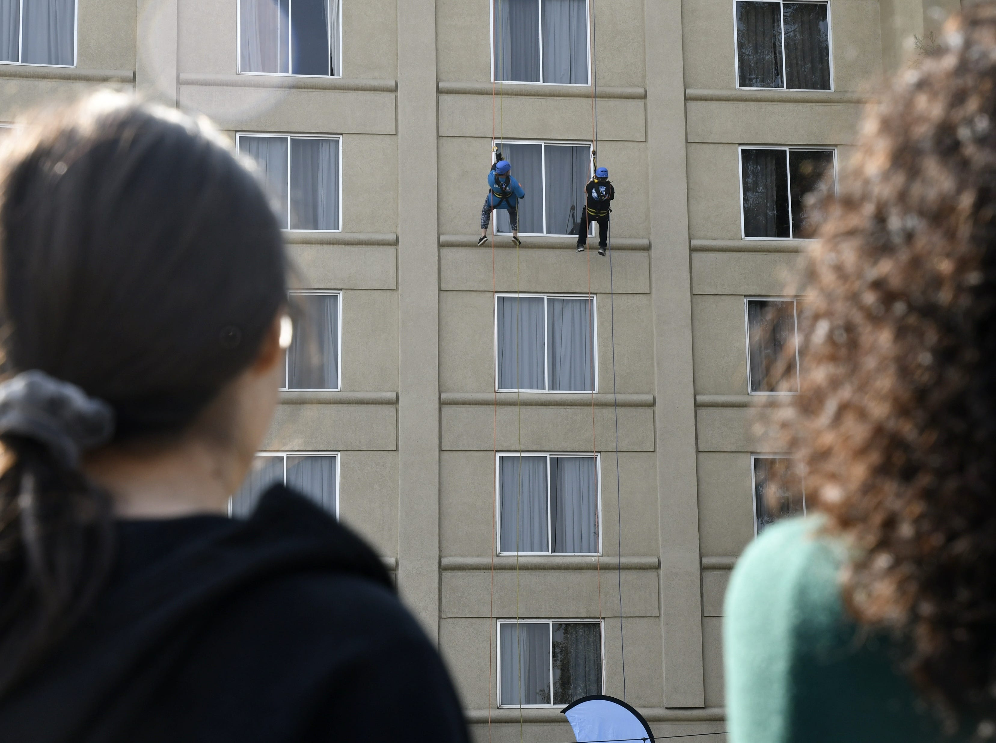 Community members rappel down the side of the Visalia Marriott at the Convention Center in downtown Visalia for the first Over the Edge fundraising event for The Source LGBT+ Center on Saturday, November 10, 2018.