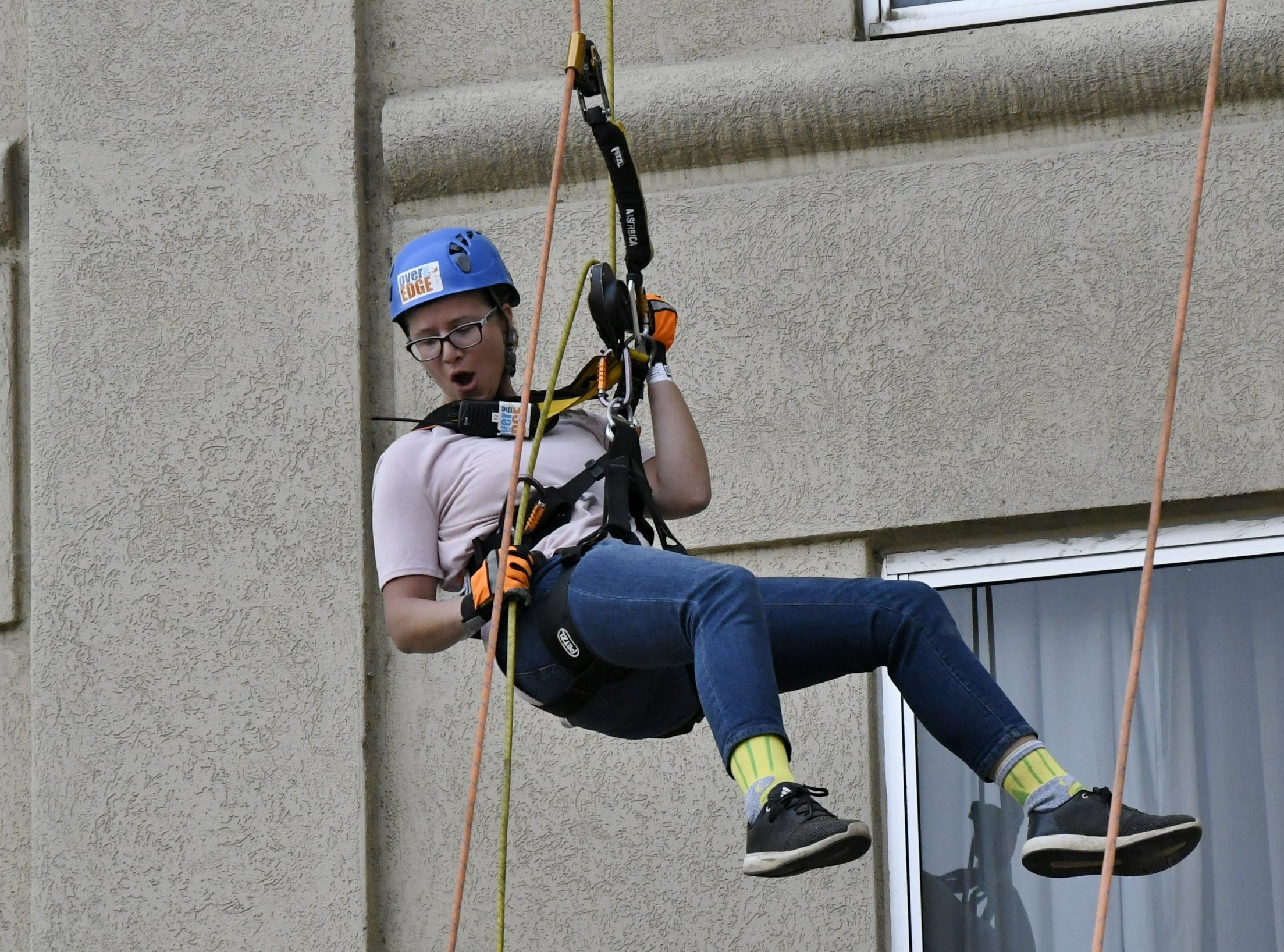 Mary West rappels down the side of the Visalia Marriott at the Convention Center in downtown Visalia for the first Over the Edge fundraising event for The Source LGBT+ Center on Saturday, November 10, 2018.