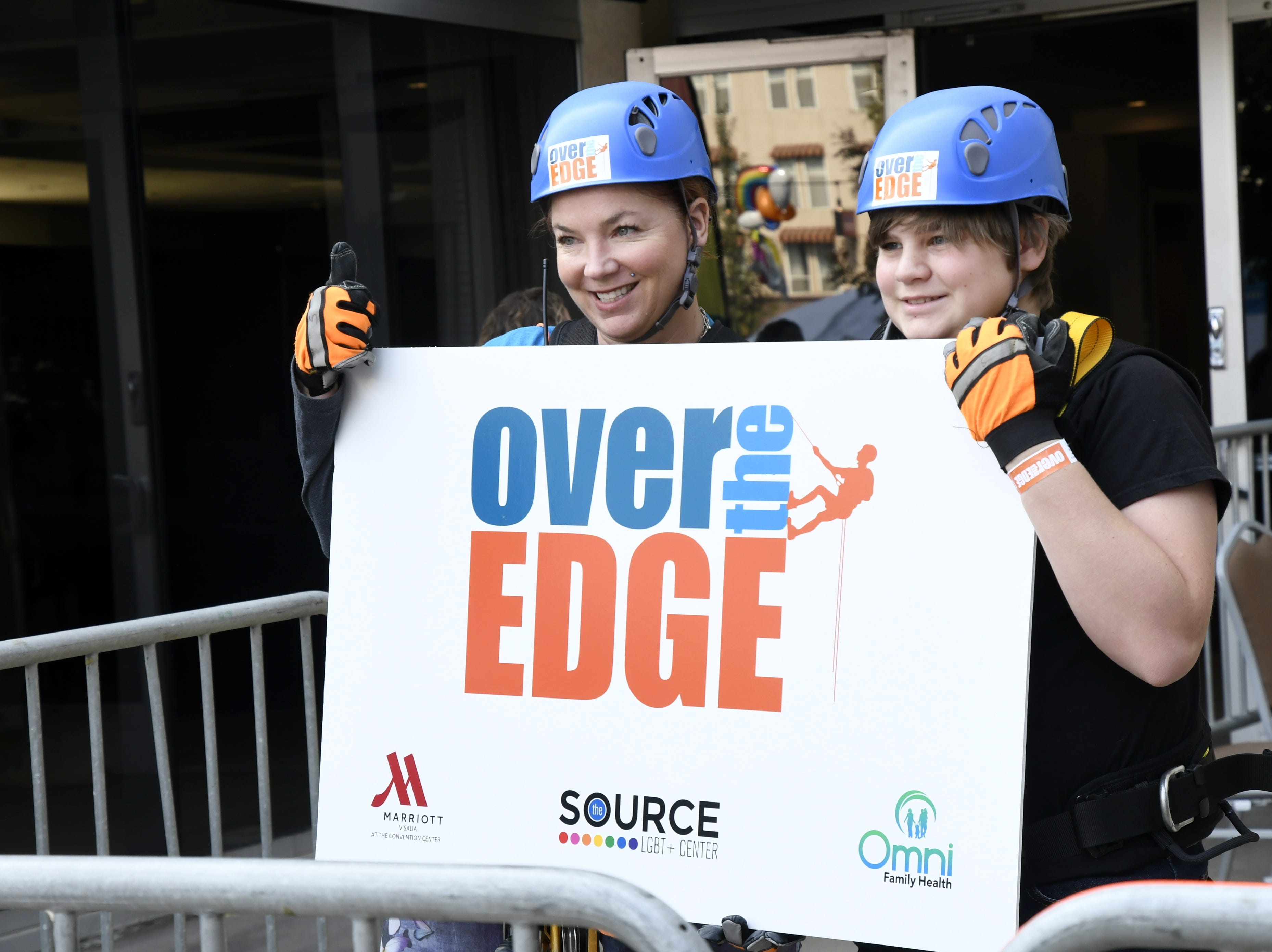 Dana and Cole Galante pose for a photo after rappelling down the side of the Visalia Marriott at the Convention Center in downtown Visalia for the first Over the Edge fundraising event for The Source LGBT+ Center on Saturday, November 10, 2018.