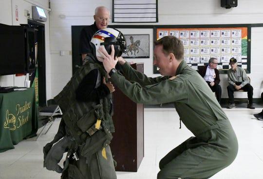U.S. Navy Lt. Matthew McDonald helps Ivanhoe Elementary fifth-grader Joanna Arce Nunez, 10, try on flight gear on Friday, November 9, 2018.