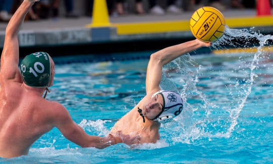 El Diamante's Matthew Hatcher shoots under pressure from Garces' Josh Pavletich in a Central Section Division II boys water polo championship on Saturday, November 10, 2018.