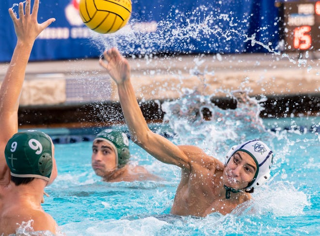 El Diamante's Robert Perez shoots against Garces in a Central Section Division II boys water polo championship on Saturday, November 10, 2018.