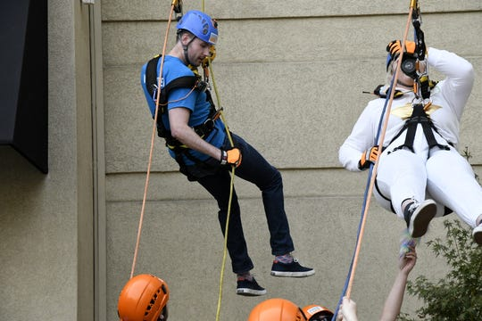 Bradley Rutledge and Katie McDonald rappel down the side of the Visalia Marriott at the Convention Center in downtown Visalia for the first Over the Edge fundraising event for The Source LGBT+ Center on Saturday, November 10, 2018.