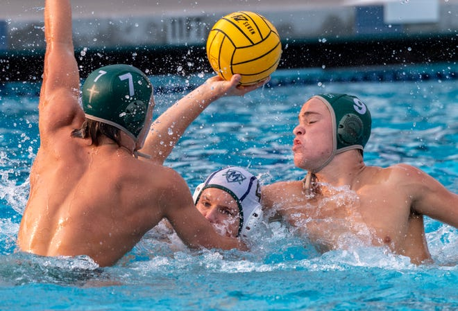 El Diamante's Collin Chase tries to pass under pressure from Garces' Joe Starr, left, and George Rice in a Central Section Division II boys water polo championship on Saturday, November 10, 2018.
